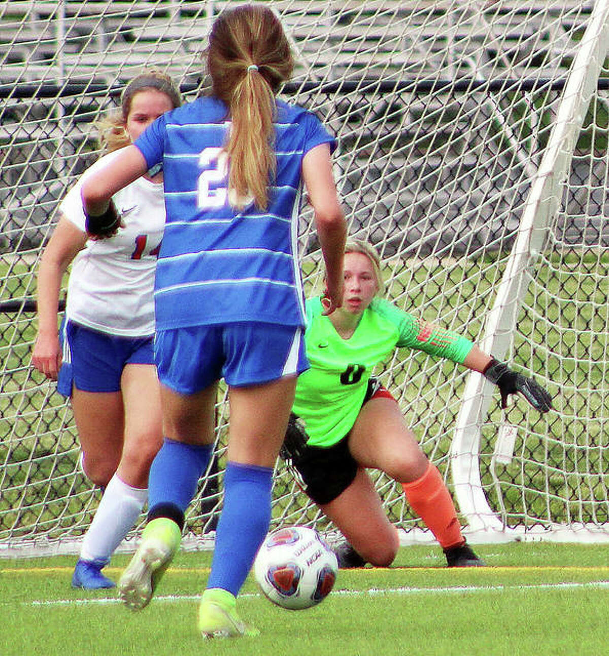Roxana goalie Kaylyn Dixon keeps a close eye on the ball as Marquette's Jillian Nelson bears down on her during Friday's game at Gordon Moore Park.