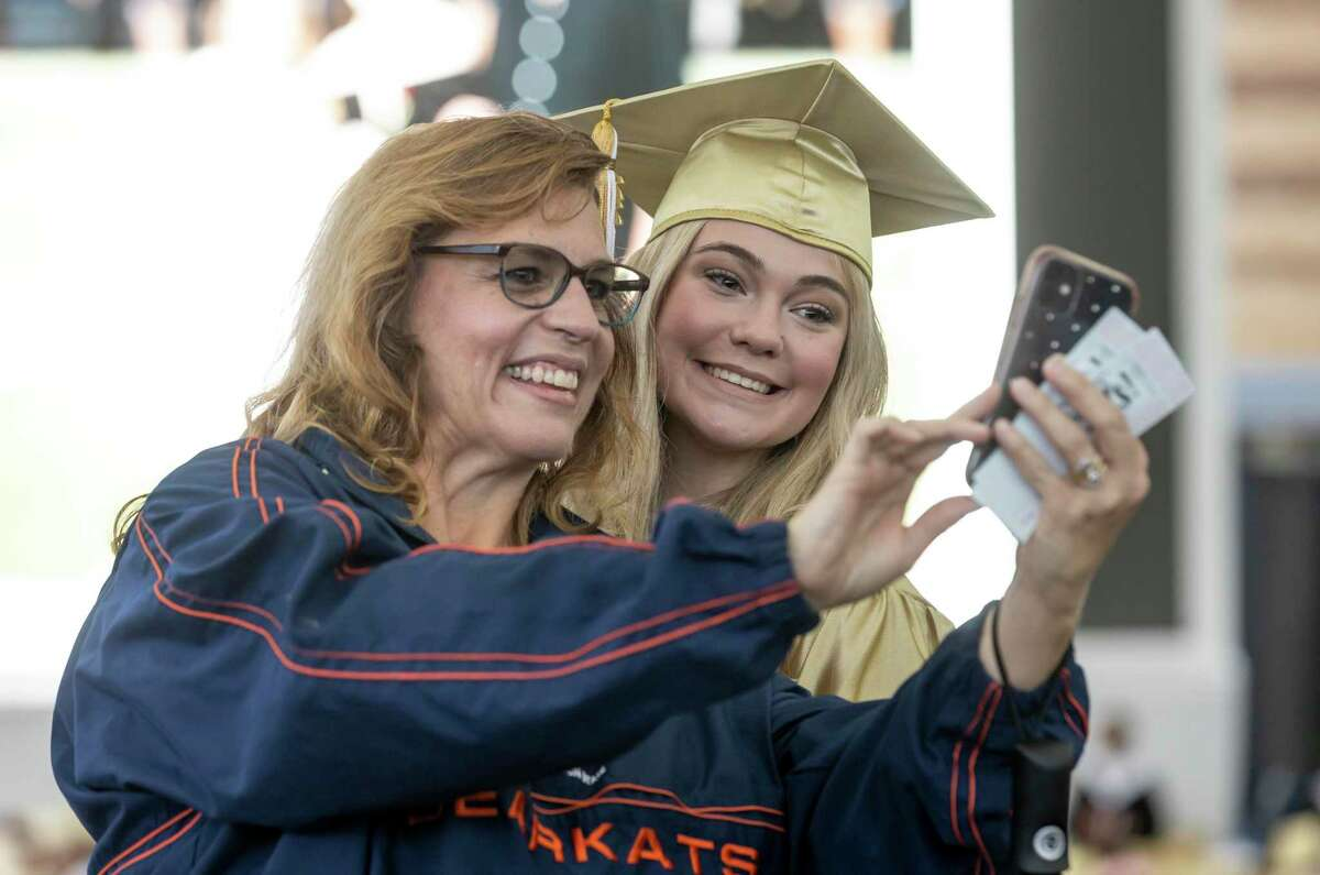 Katie Lynch, right, takes a selfie with her aunt, Deborah Miller, before Conroe High School's graduation ceremony at the Cynthia Woods Mitchell Pavilion, Friday, May 21, 2021, in The Woodlands.