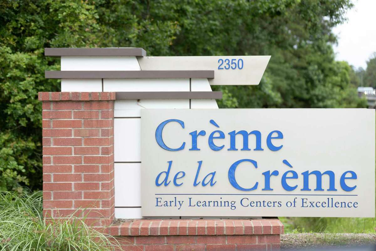 Signage to the entrance of Crème de la Crème is seen, Friday, May 21, 2021, in The Woodlands.