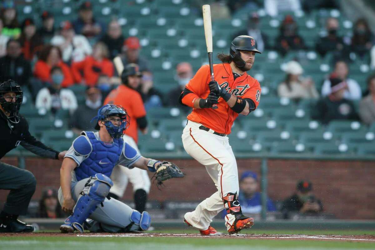 San Francisco Giants shortstop Brandon Crawford (35) hits a ball foul in the first inning during an MLB game against the Los Angeles Dodgers at Oracle Park, Friday, May 21, 2021, in San Francisco, Calif.