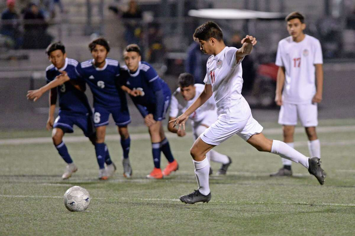 Bryan Rivas-Guzman (11) of Terry scores on a penalty kick during the second half of a high school soccer game between the Terry Texans and the Lamar Consolidated Mustangs on Friday, March 8, 2019 at Traylor Stadium, Rosenberg, TX.
