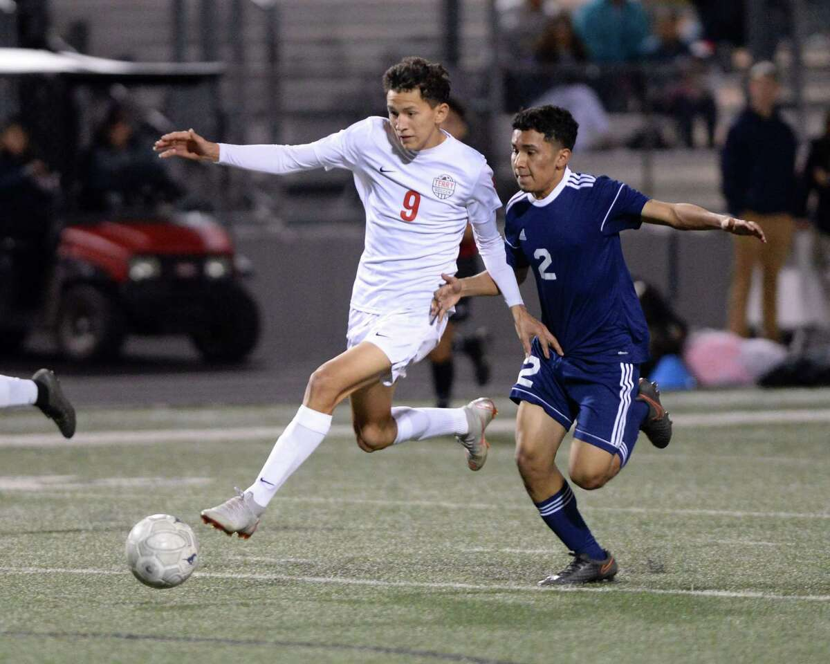 Ronald Aguilar (9) of Terry dribbles past Alan Jimenez (2) of Lamar Consolidated during the second half of a high school soccer game between the Terry Texans and the Lamar Consolidated Mustangs on Friday, March 8, 2019 at Traylor Stadium, Rosenberg, TX.
