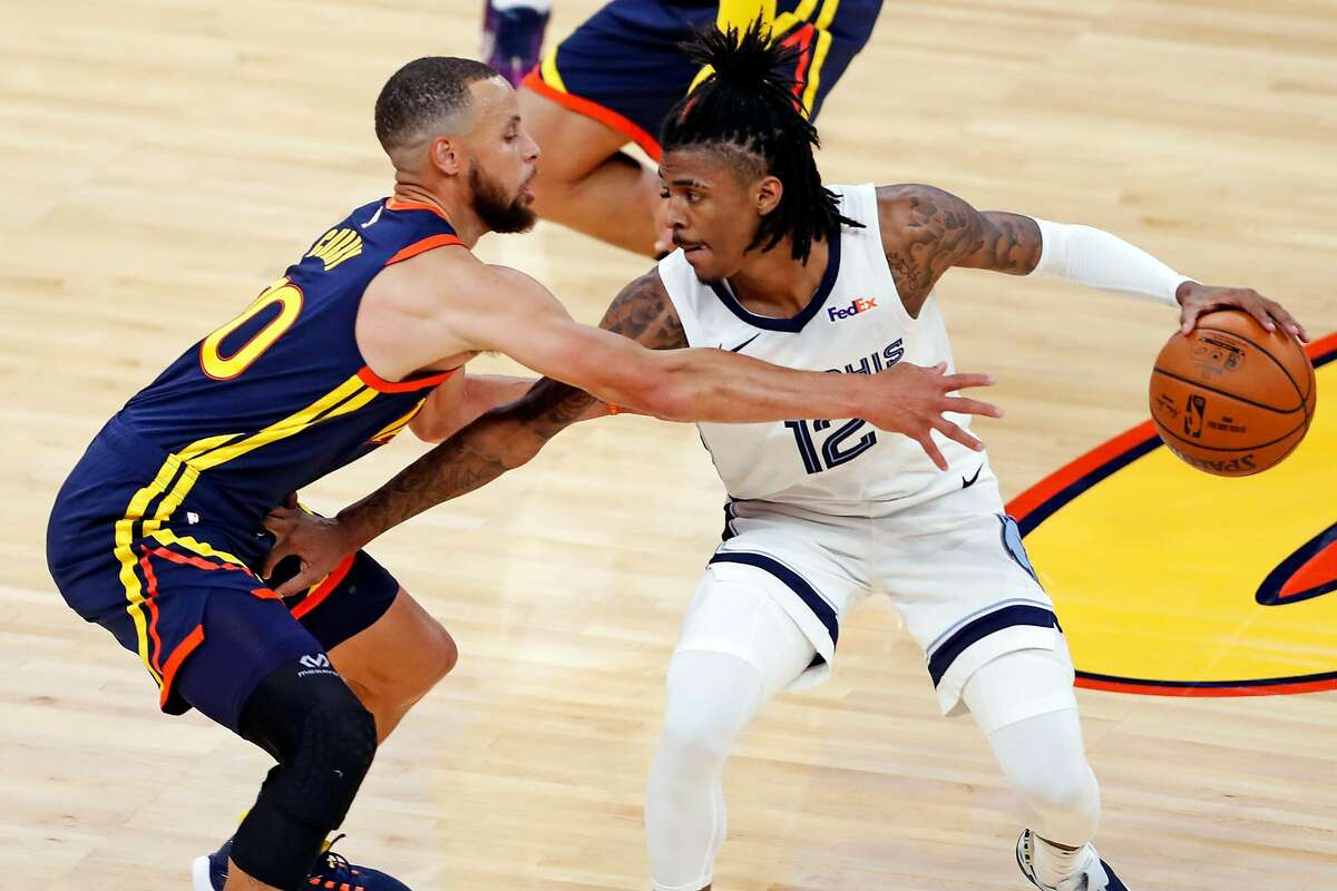 Golden State Warriors' Stephen Curry guards Memphis Grizzlies' Ja Morant during 1st quarter of NBA Play-In Tournament game at Chase Center in San Francisco, Calif., on Friday, May 21, 2021.