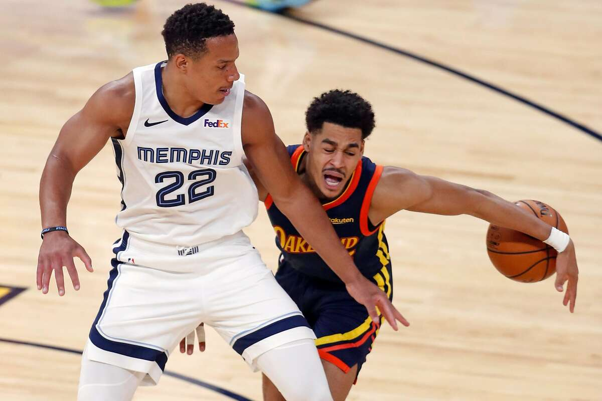 Golden State Warriors' Jordan Poole is fouled by Memphis Grizzlies' Desmond Bane during 3rd quarter of NBA Play-In Tournament game at Chase Center in San Francisco, Calif., on Friday, May 21, 2021.