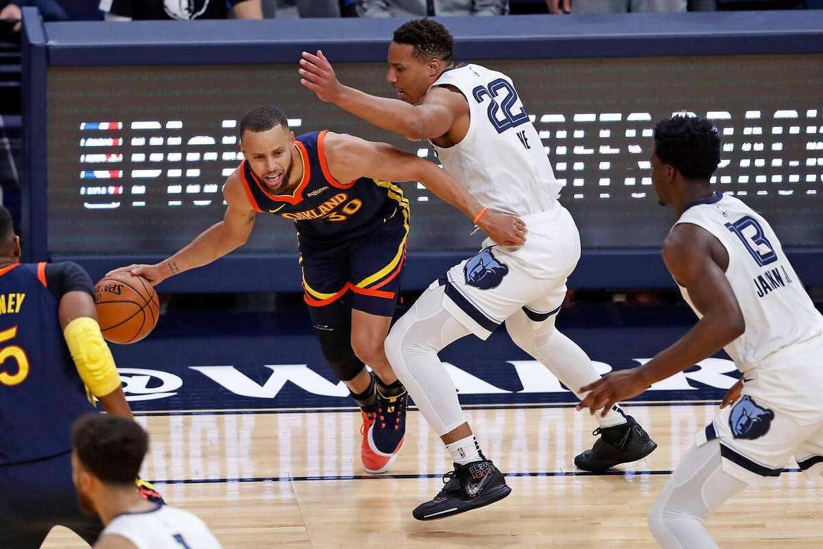 Golden State Warriors' Stephen Curry looks for room to dribble against Desmond Bane Memphis Grizzlies' during 1st quarter of NBA Play-In Tournament game at Chase Center in San Francisco, Calif., on Friday, May 21, 2021.