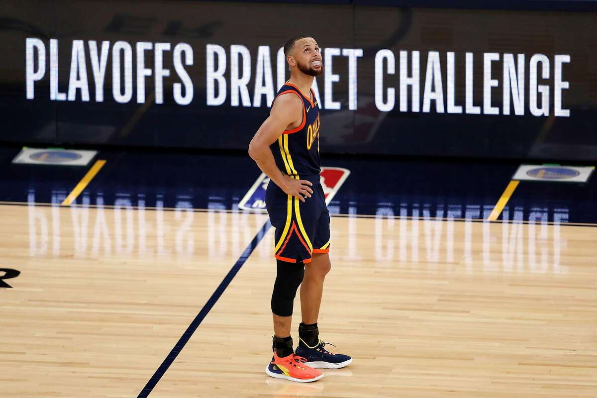 Golden State Warriors' Stephen Curry looks at scoreboard while playing Memphis Grizzlies during 1st quarter of NBA Play-In Tournament game at Chase Center in San Francisco, Calif., on Friday, May 21, 2021.