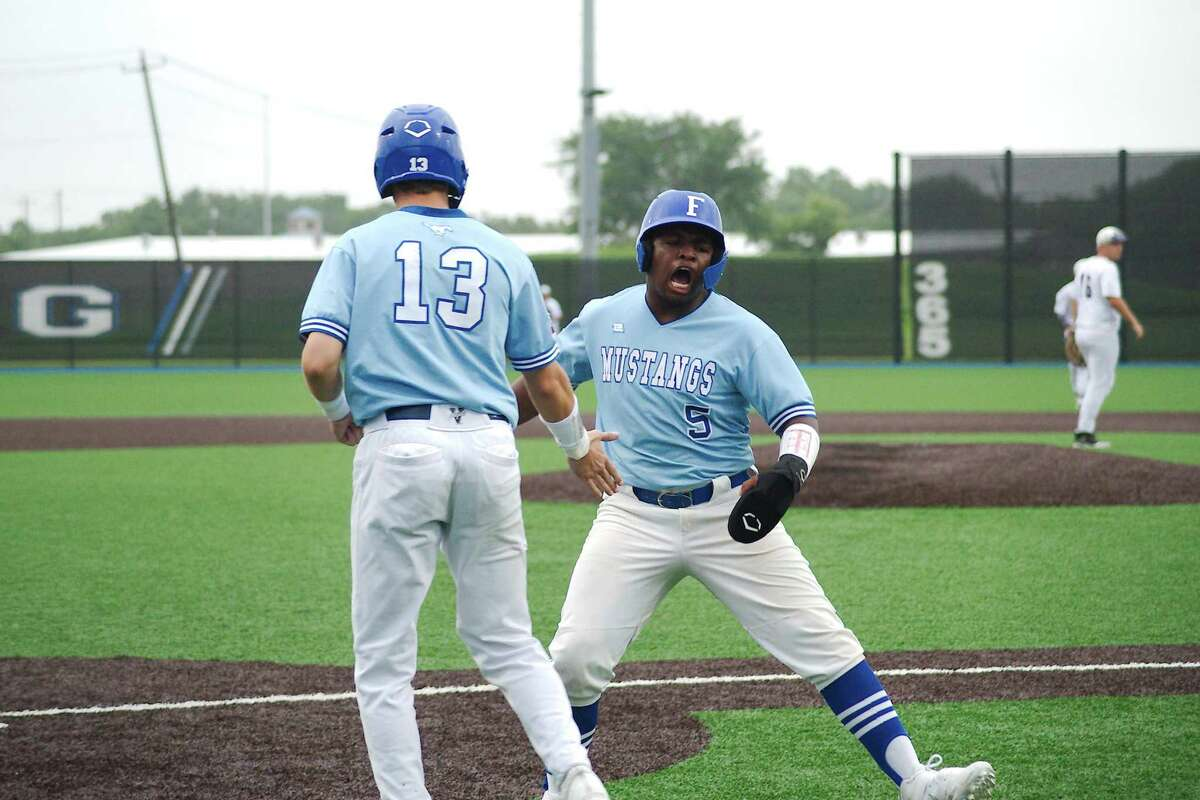 Friendswood's Kevin Newkirk (13) and Friendswood's Isaiah Winkler (5) celebrates runs scored against Port Neches Groves Friday, May 21 at Baytown Sterling High School.