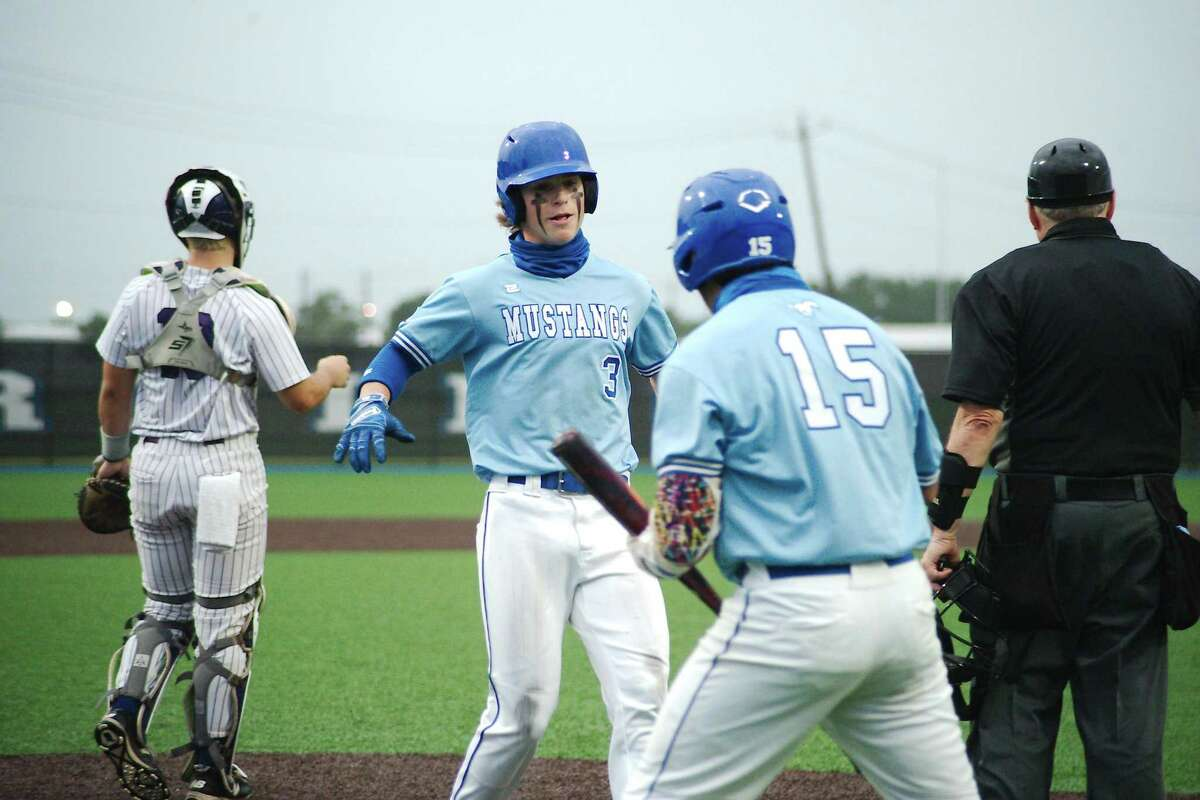 Friendswood's Caden Montemayor (3) and Friendswood's Misael Cantu (15) celebrate runs scored against Port Neches Groves Friday, May 21 at Baytown Sterling High School.