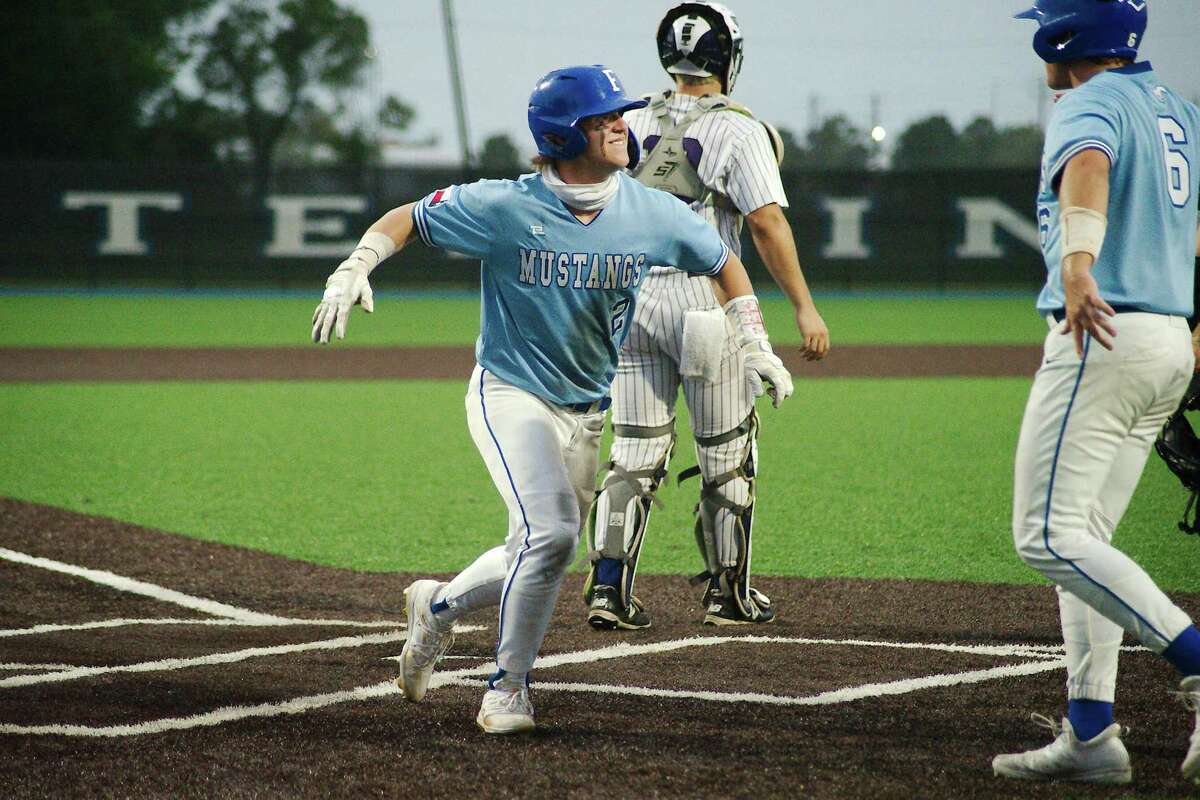 Friendswood's Landon Montemayor (2) and Friendswood's Devon Andrews (6) celebrate runs scored against Port Neches Groves Friday, May 21 at Baytown Sterling High School.