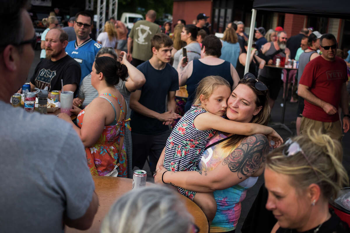 People enjoy live music, food and drinks at Red Oak Restaurant during the Sanford Rising celebration Friday, May 21, 2021 in downtown Sanford. (Katy Kildee/kkildee@mdn.net)