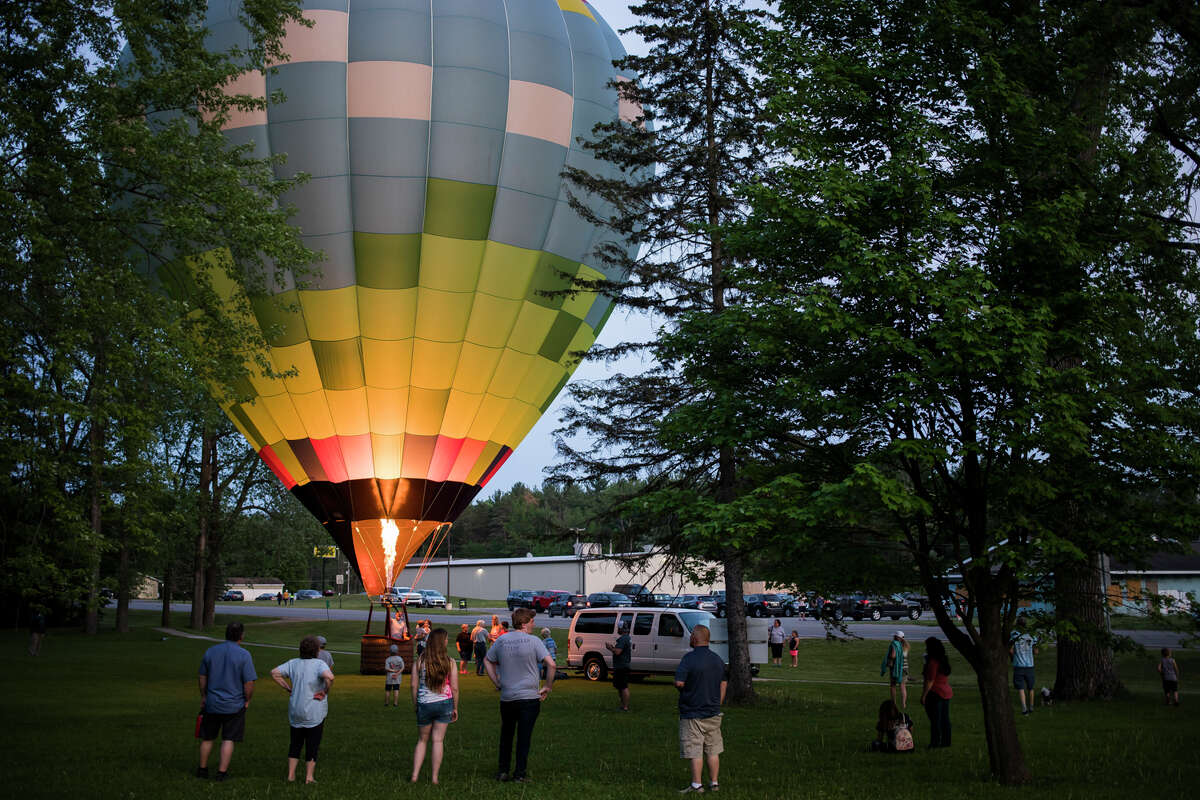 People enjoy live music and a hot air balloon glow during the Sanford Rising celebration Friday, May 21, 2021 in downtown Sanford. (Katy Kildee/kkildee@mdn.net)
