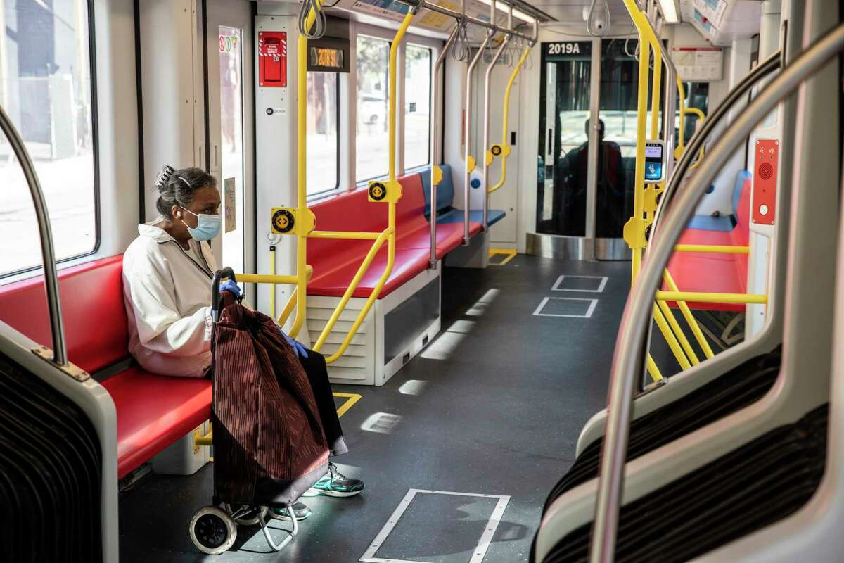 A lone passenger sits inside a Muni T-Third Street train as it travels toward Embarcadero Station this month.