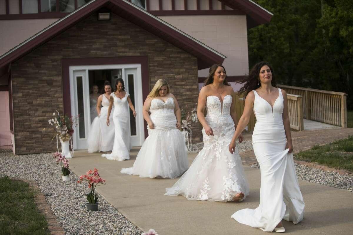 Three Diamonds Bridal hosts a runway show during Sanford Rising Friday, May 21, 2021 at the bridal shop in Sanford. (Katy Kildee/kkildee@mdn.net)
