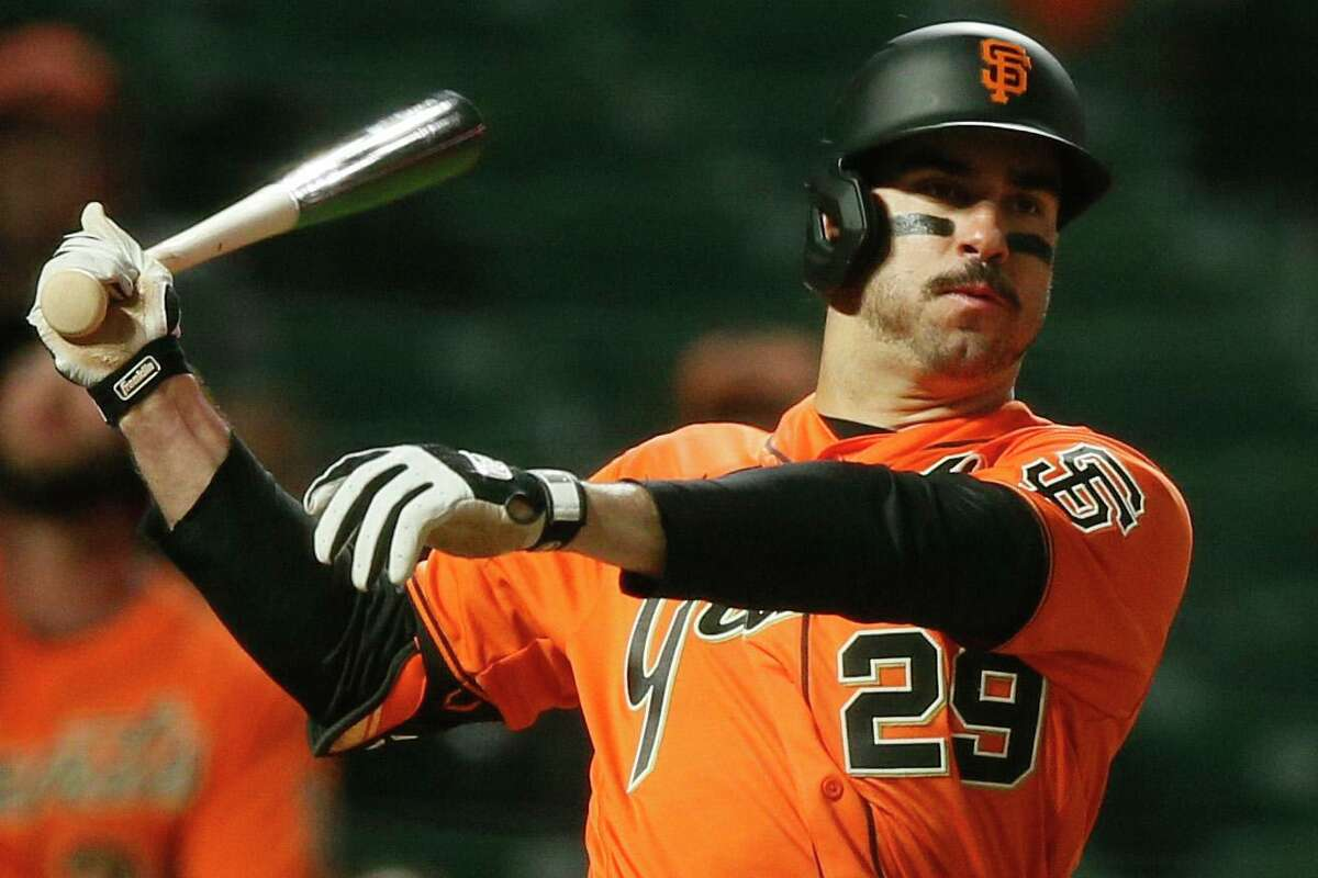 San Francisco Giants center fielder Mike Tauchman (29) fouls a ball in the seventh inning during an MLB game against the Los Angeles Dodgers at Oracle Park, Friday, May 21, 2021, in San Francisco, Calif.