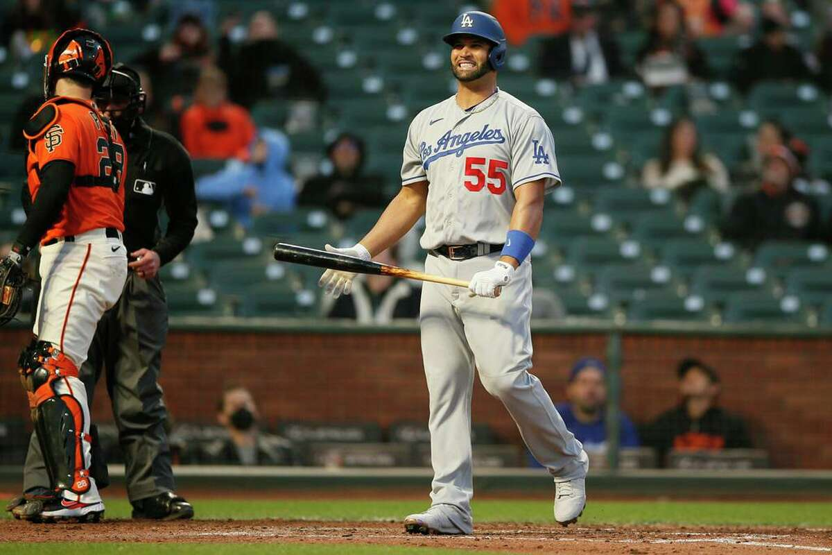 Los Angeles Dodgers first baseman Albert Pujols (55) reacts after hitting a ball foul in the fifth inning during an MLB game against the San Francisco Giants at Oracle Park, Friday, May 21, 2021, in San Francisco, Calif.