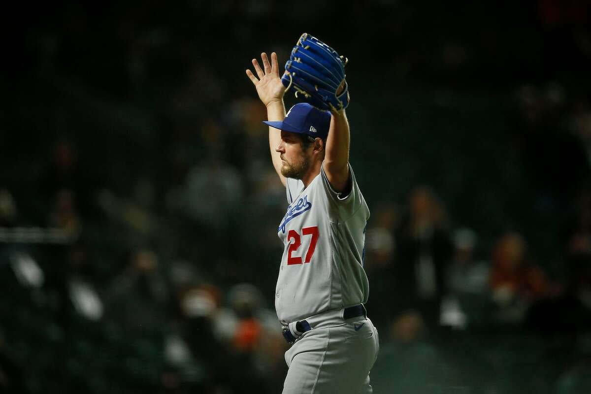 Los Angeles Dodgers starting pitcher Trevor Bauer (27) pumps up the crowd as he's taken out of the seventh inning during an MLB game against the San Francisco Giants at Oracle Park, Friday, May 21, 2021, in San Francisco, Calif.