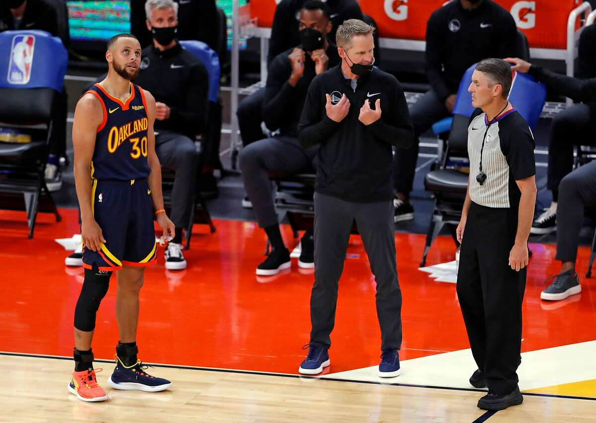 Golden State Warriors' head coach Steve Kerr and Stephen Curry question an official's call while playing Memphis Grizzlies during 2nd quarter of NBA Play-In Tournament game at Chase Center in San Francisco, Calif.,on Friday, May 21, 2021.