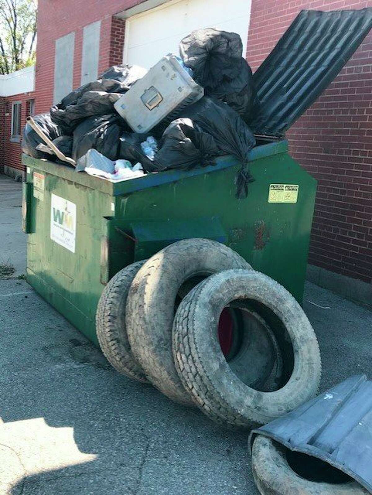 A dumpster is overloaded with trash students collected during the clean-up event. (Courtesy Photo)