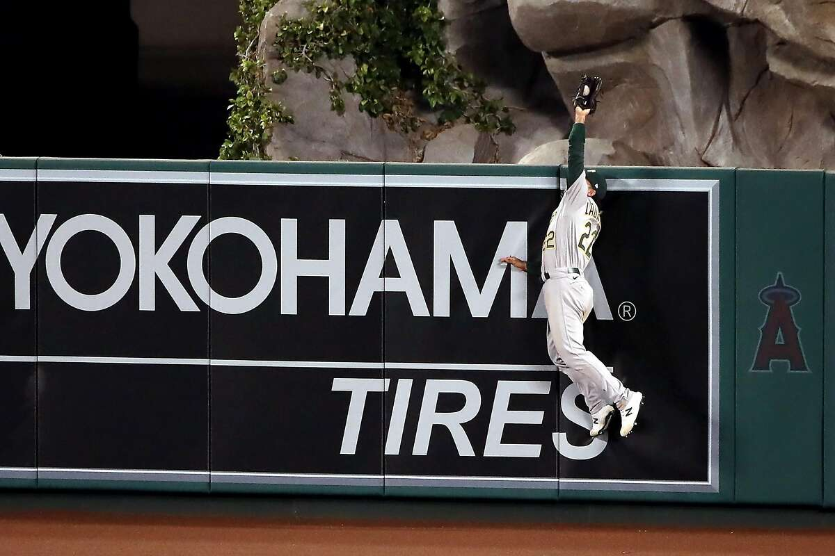 ANAHEIM, CALIFORNIA - MAY 21: Ramon Laureano #22 of the Oakland Athletics catches a ball hit by Anthony Rendon #6 of the Los Angeles Angels during the seventh inning at Angel Stadium of Anaheim on May 21, 2021 in Anaheim, California. (Photo by Katelyn Mulcahy/Getty Images)