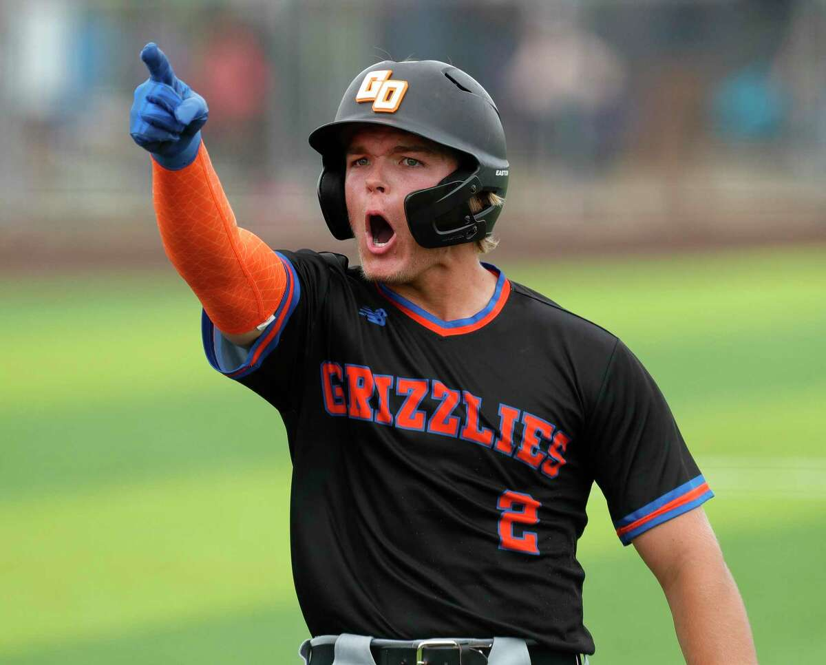 FILE PHOTO - Connor McBryde #2 of Grand Oaks reacts after scoring on an error by Tomball Memorial shortstop Robert Oropeza in the third inning of a Region II-6A area high school playoff game at Tomball Memorial High School, Saturday, May 15, 2021, in Tomball.