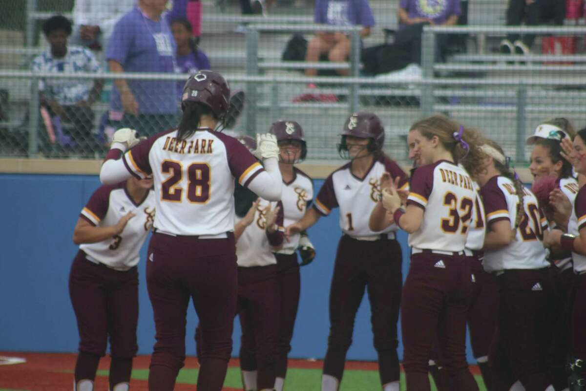 Madison Applebe trots home to a welcoming committee after smacking a grand slam in the second inning Friday night. She finished with five RBIs.