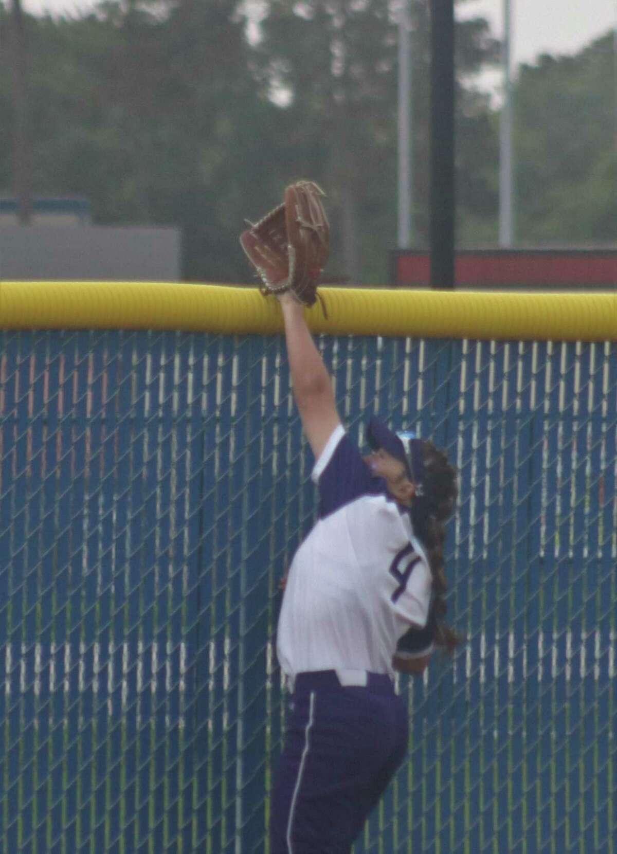 Ridge Point's left fielder tries in vain to prevent Madison Applebe's grand slam Friday night.