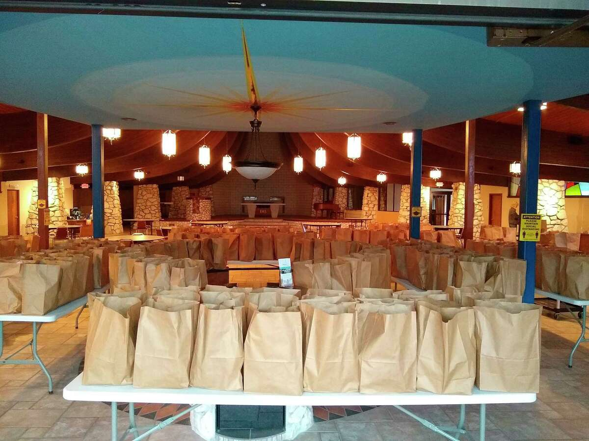 MCCOA staff and volunteers ready the bags for what looks to be the last drive through monthly food bank. June's food bank will be held indoors, for the first time in nearly a year and a half. (Courtesy Photo/Jeanne Barber)