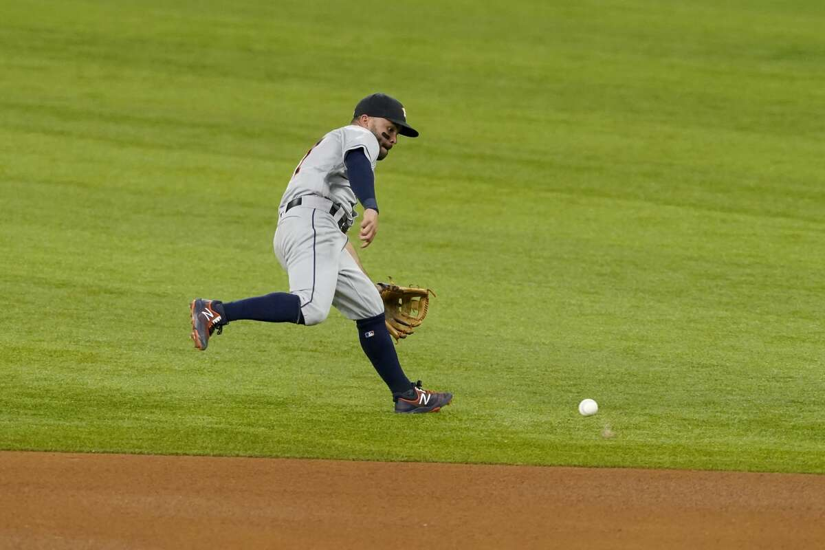 Houston Astros second baseman Jose Altuve chases down a single by Texas Rangers' Isiah Kiner-Falefa in the fourth inning of a baseball game in Arlington, Texas, Friday, May 21, 2021. (AP Photo/Tony Gutierrez)