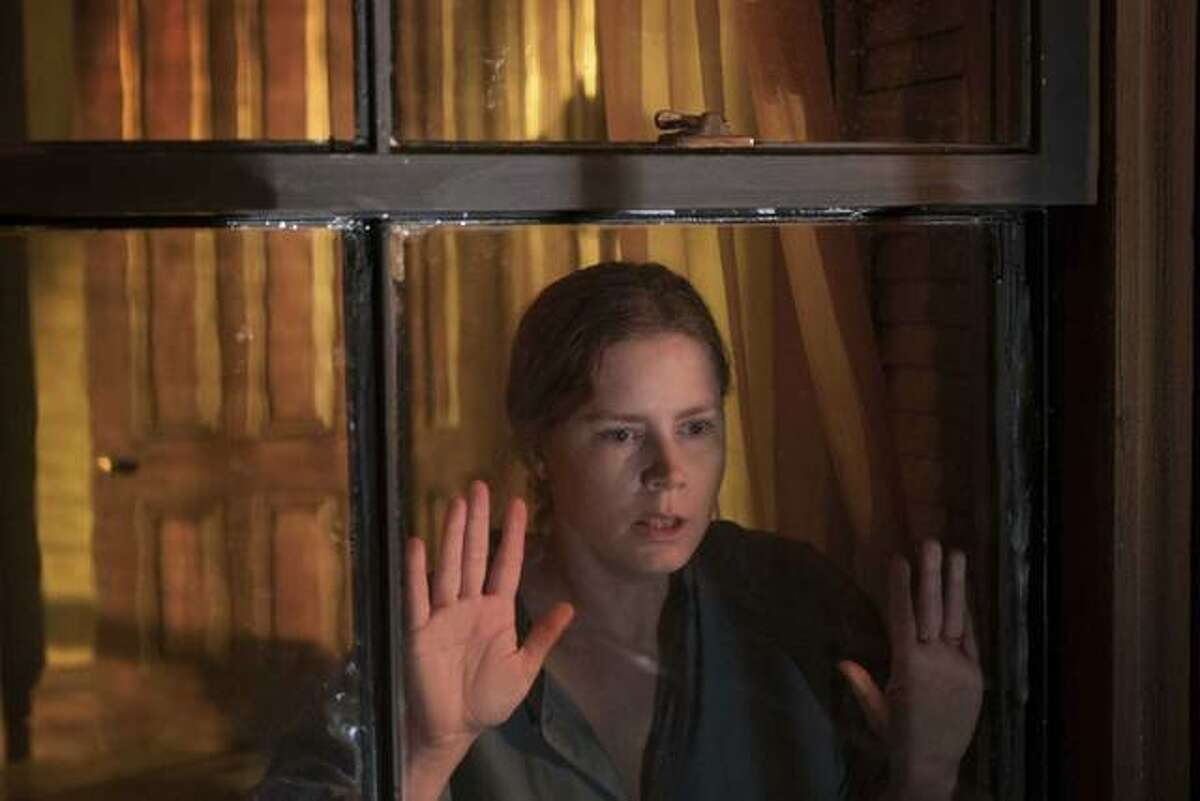 """This image released by Netflix shows Amy Adams in a scene from """"The Woman in the Window."""""""