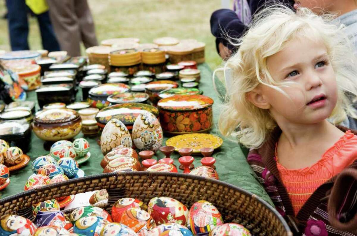 Arden Douglas, 3, browses the pysanka, traditional Ukranian Easter eggs, during the 43rd Annual Ukrainian Festival at St. Basil College Sunday, September 12, 2010. Hundreds turned out for an outdoor liturgy followed by ethnic food like Borscht, potato dumplings and stuffed cabbage and traditional dance performances.