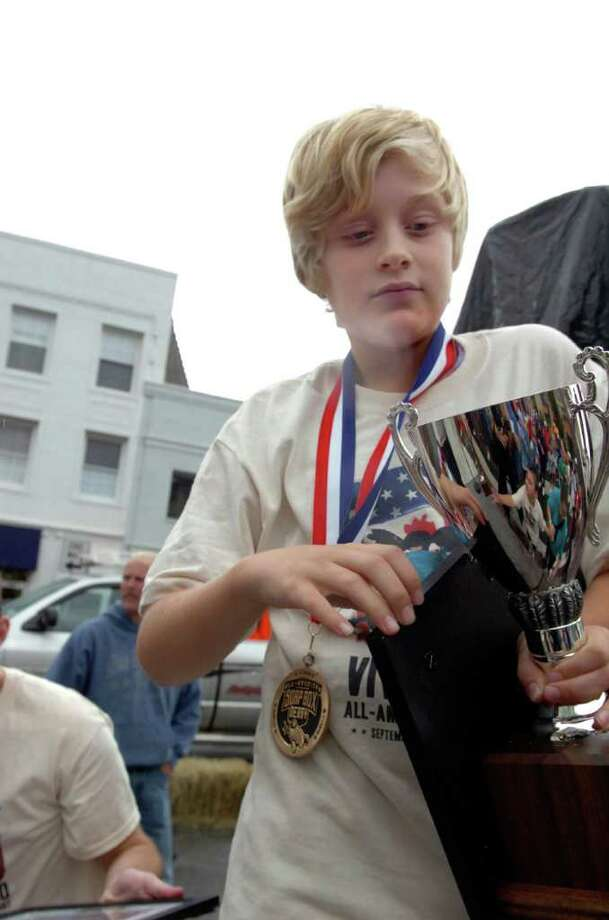 Justin Krumlauf, 11, won first place at the Soap Box Derby on Sunday, Sept. 12, 2010. Photo: Helen Neafsey / Greenwich Time
