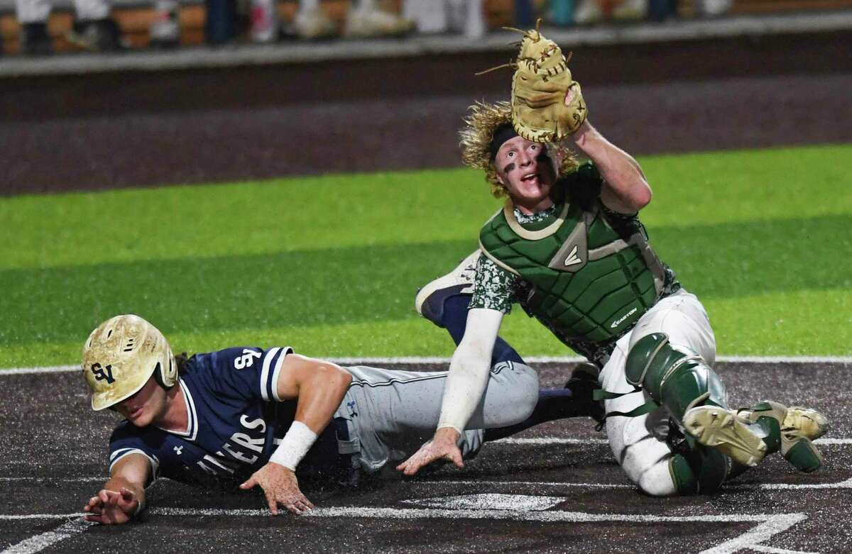 Reagan catcher Ryan Beaird checks for the ball in his glove after tagging out Christian Keller of Smithson Valley during Game 2 of the 6A regional quarterfinal series at North East Sports Park on Friday, May 21, 2021. Reagan won, 4-1.