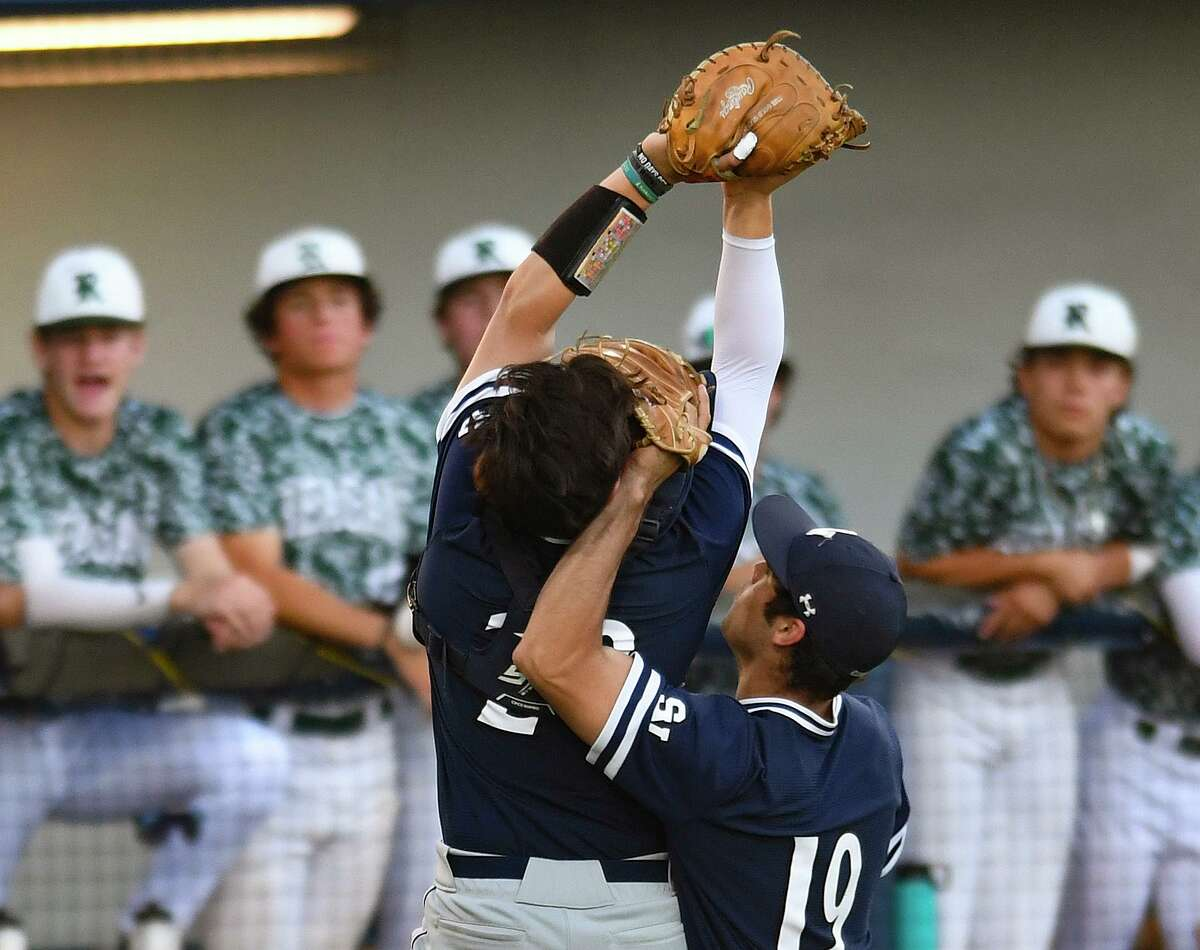 Smithson Valley catcher Ethan Gonzalez catches a pop foul ball despite getting a glove to the face from pitcher Tim Arguello during Game 2 of the 6A regional quarterfinal series against Reagan at North East Sports Park on Friday, May 21, 2021.