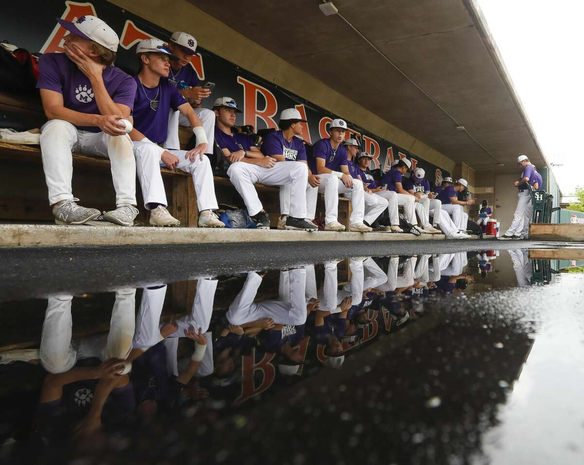 Montgomery players wait in the dugout during a weather delay prior to Game 2 of a high school baseball Region II-6A quarterfinal series at Sam Houston State University, Friday, May 21, 2021, in Huntsville.