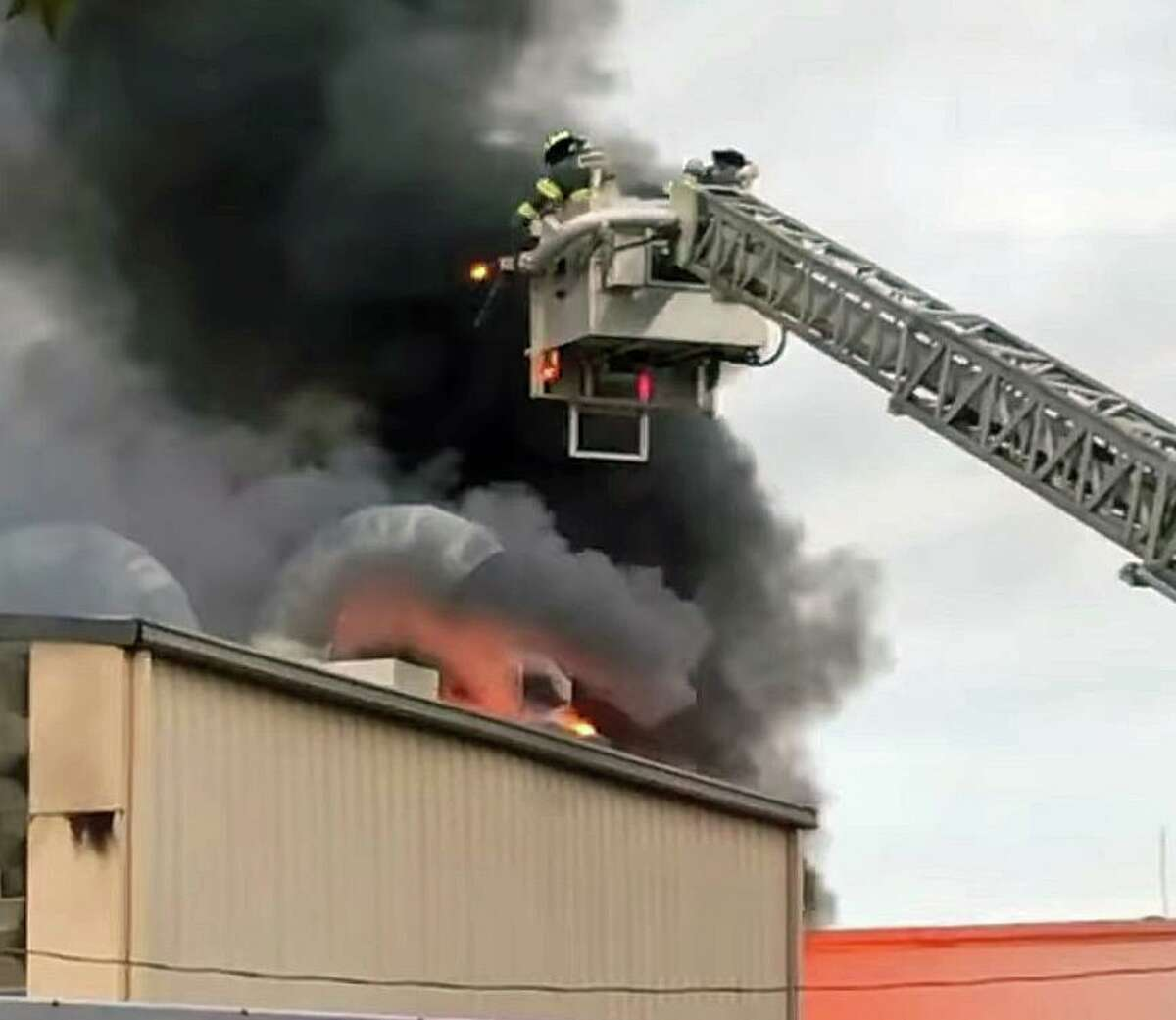 Crews battle a fire in Norwalk, Conn., on Saturday, May 22, 2021.