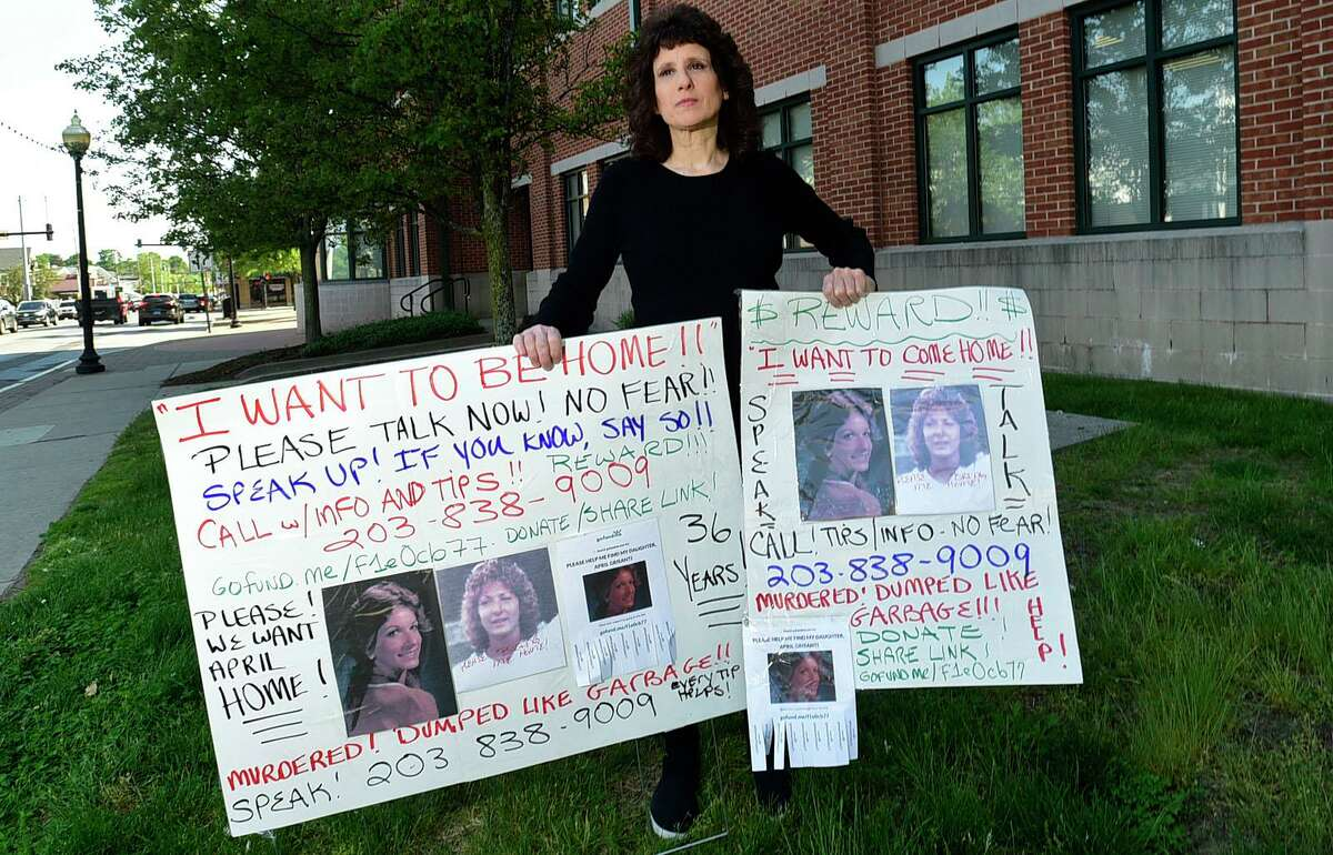 Gina Grisanti at Norwalk Police Station Wednesday, May 19, 2021, in Norwalk, Conn. Grisanti is trying to find the remains of her sister April, who went missing in 1985. She has posted signs across the city asking for information.