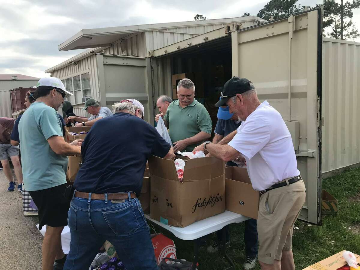 The Society of Samaritans at a recent food drive. The group provides food, clothes and financial assistance to Montgomery County residents in need.
