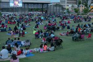 Midlanders come out of an evening family picnic before the first Movie in the Park, showing Croods: A New Age 5/21/2021 at Centennial Plaza. Tim Fischer/Reporter-Telegram