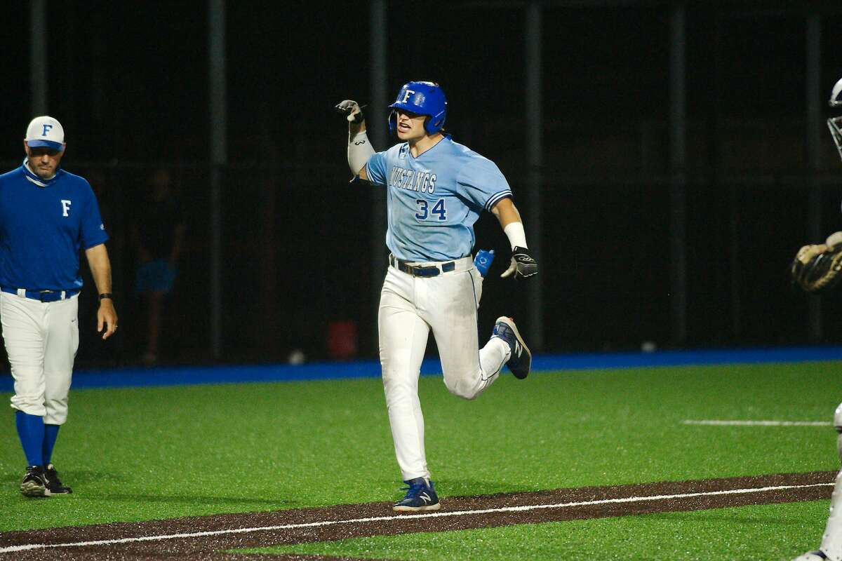 Friendswood's Izaac Pacheco (34) celebrates after hitting a homerun against Port Neches Groves Friday, May 21 at Baytown Sterling High School.