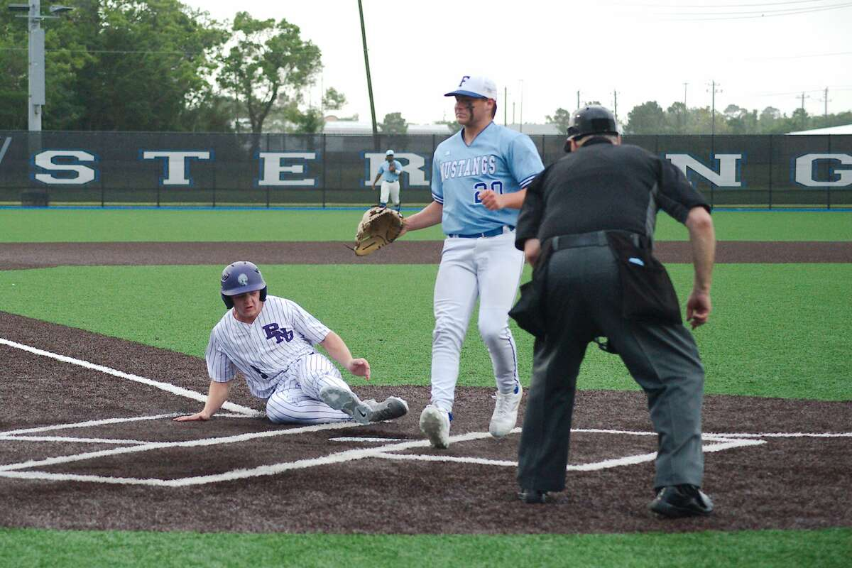 Friendswood's Jaxson Burch (20) chases a wild throw as Port Neches Groves' Chase Johnson (9) slides into home plate Friday, May 21 at Baytown Sterling High School.