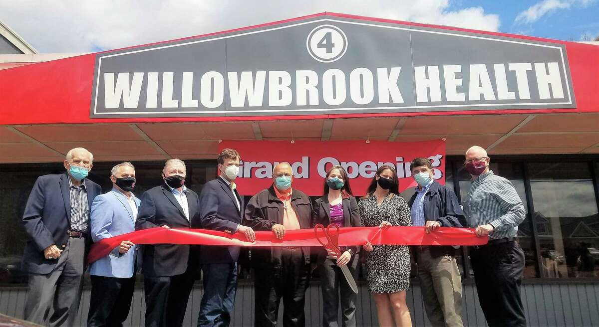Willowbrook Health Center in Cromwell celebrated a grand opening April 30. From left are Middlesex County Chamber of Commerce President Larry McHugh, plaza business owner Chris Cambareri, past chamber chairman and Willowbrook Spirit Shoppe owner Jay Polke, state Sen. Matt Lesser, Town Manager Anthony Salvatore, owner Sara Frawley, state Rep. Christie Carpino, Town Planner Stuart Popper and Chamber Chairman Tom Byrne.