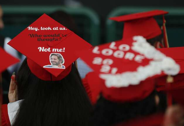 Decorated graduation caps are seen during a Caney Creek High School graduation ceremony at Cynthia Woods Mitchell Pavilion, Saturday, May 22, 2021, in The Woodlands. Photo: Jason Fochtman/Staff Photographer / 2021 © Houston Chronicle