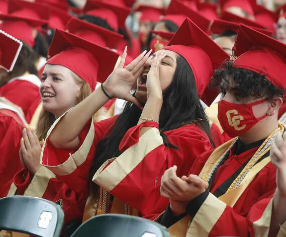 Caney Creek student Yiseira Garcia cheers as classmates are annouced during a graduation ceremony at Cynthia Woods Mitchell Pavilion, Saturday, May 22, 2021, in The Woodlands. Photo: Jason Fochtman/Staff Photographer / 2021 © Houston Chronicle