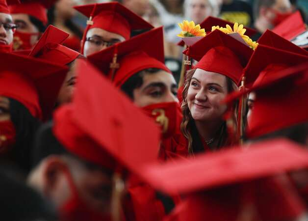 Caney Creek student Grace Stroher watches a video while wearing a decorated graduation cap during a ceremony at Cynthia Woods Mitchell Pavilion, Saturday, May 22, 2021, in The Woodlands. Photo: Jason Fochtman/Staff Photographer / 2021 © Houston Chronicle