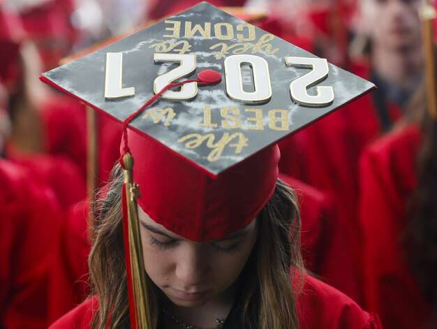 Caney Creek student Sydney Armer prays during a graduation ceremony at Cynthia Woods Mitchell Pavilion, Saturday, May 22, 2021, in The Woodlands. Photo: Jason Fochtman/Staff Photographer / 2021 © Houston Chronicle