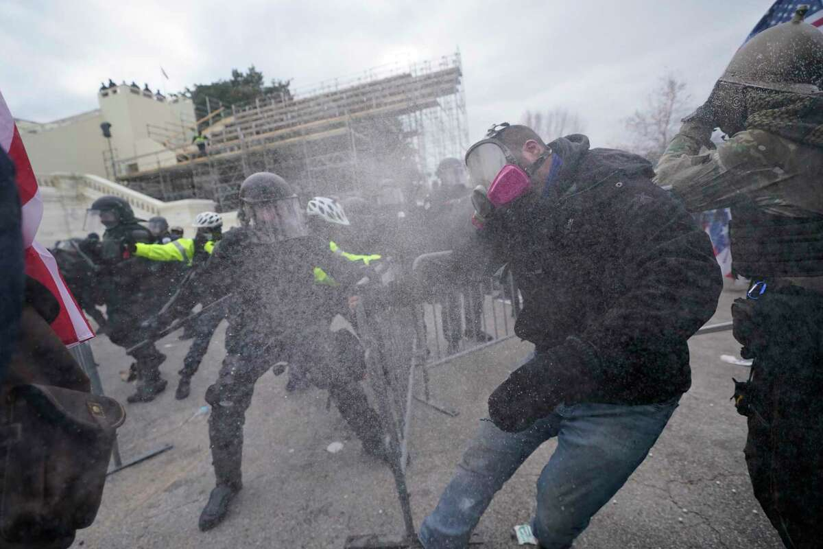 Supporters of then-President Donald Trump try to break through a police barrier at the Capitol in Washington on Jan 6. (AP Photo/Julio Cortez, File)