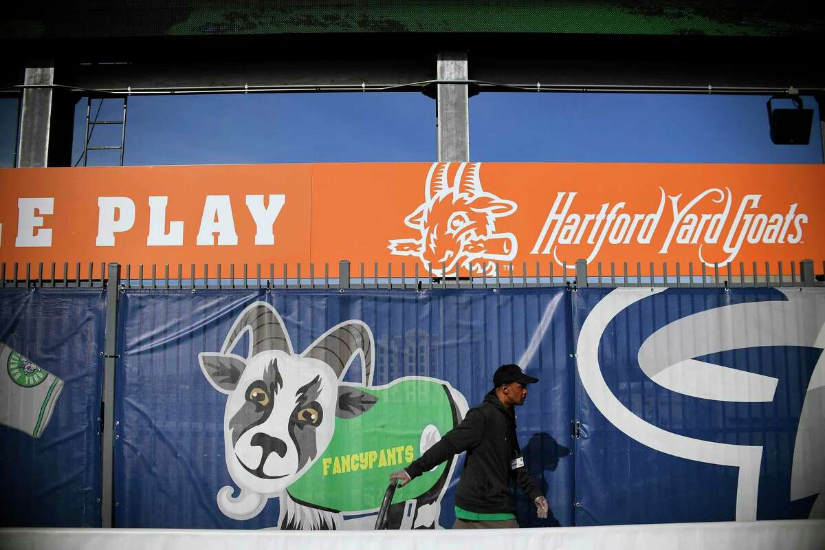A Hartford Yard Goats employee pulls a cart through the picnic pavilion area in the outfield of Dunkin' Donuts Park before a 2019 game.
