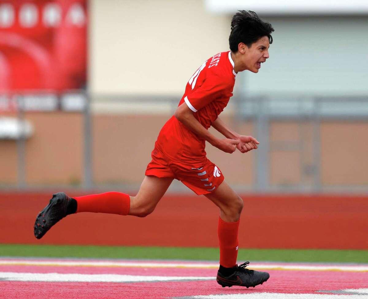 Splendora's Baruc Delgado (10) reacts after scoring a goal to tie the match 1-1 during the first period of a Region III-4A quarterfinal high school soccer match at Wildcat Stadium, Saturday, April 3, 2021, in Splendora.