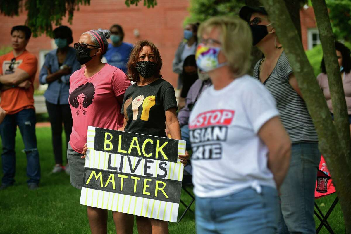Anna Loper, center, atttends an anti-racism rally at Trumbull Town Hall Green.