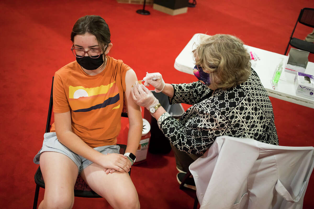 Keira Shaffner, 13, left, receives her COVID-19 vaccine from Walgreens Pharmacist Tammy Allington, right, during a clinic at the Midland Center for the Arts Saturday, May 22, 2021 in Midland. (Katy Kildee/kkildee@mdn.net)